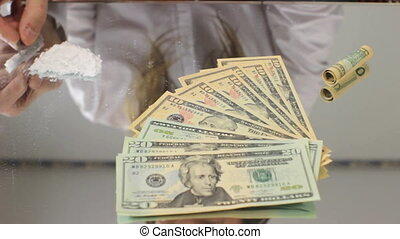 Drug Dealer - Drug dealer preparing coke or heroin for...