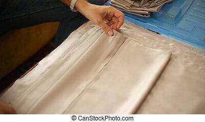 female hands folded napkin for wedding decoration holiday