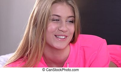 Blonde girl in a pink jacket, closeup - Blonde girl with...