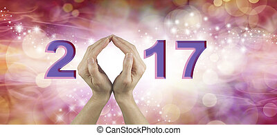 Welcome 2017 with both hands - Female using both hands to...