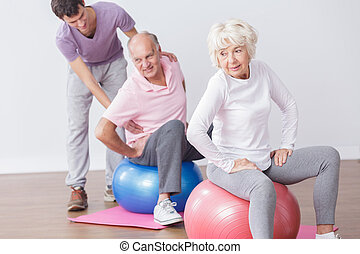 Exercise for good mood and for health - Seniors exercising...