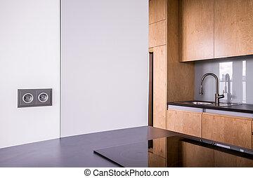 Modern wooden kitchen - Modern kitchen with black countertop...