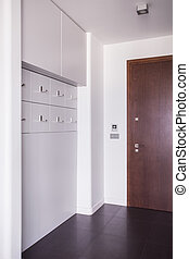 Apartment front door - Brown front door to roomy modern...