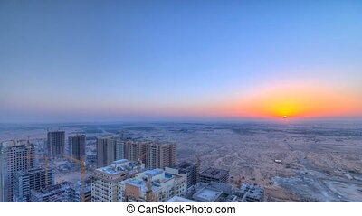 Cityscape of Ajman from rooftop with sunrise timelapse. Ajman is the capital of the emirate of Ajman in the United Arab Emirates.