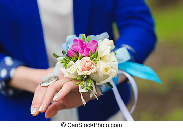 bouquet on his hand bridesmaids - Bridesmaids holding a...