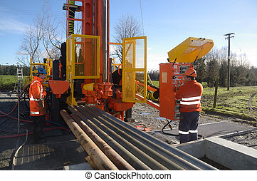 packing up - Drilling crewmen remove pipes from the...