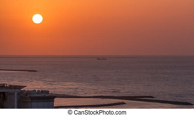 Sunset in Ajman from rooftop timelapse. Ajman is the capital of the emirate of Ajman in the United Arab Emirates.