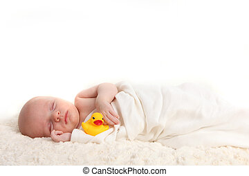 Swaddled Infant Holding a Rubber Duckie - Sleeping Swaddled...