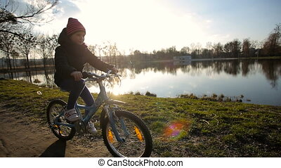 Young Girl Riding the Bike 3