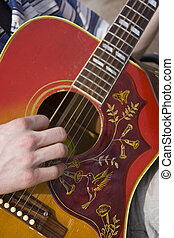 Strumming Guitar - Hand strumming a six string acoustic...