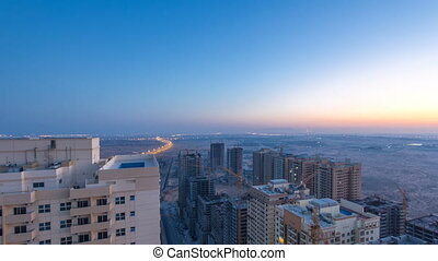 Cityscape of Ajman from rooftop night to day timelapse. Ajman is the capital of the emirate of Ajman in the United Arab Emirates.