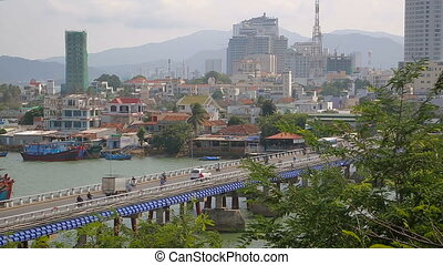 Nha Trang, Vietnam - Many people and vehicles on the main...