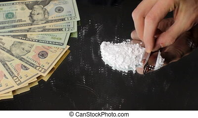 Drugs and Money 1 - Drug dealer preparing coke or heroin for...