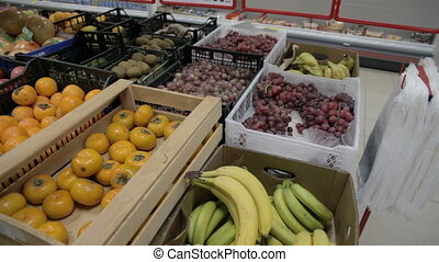 fruit store lemons bananas apples oranges pomelo at the...