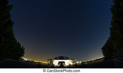 starry night on the desert in UAE timelapse with small house...