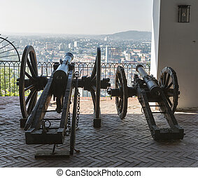 Old cannon on gun carriage aims to Graz, Austria