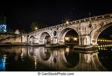 Beautiful bridge over the Tiber at night in Rome
