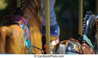 Amusement park carousel with beautifully painted wooden...