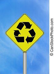 Recycle sign - A black and yellow recycle sign with the...