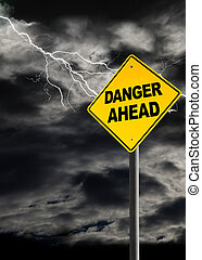 Danger Ahead Sign Against Cloudy and Thunderous Sky - Danger...