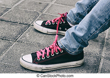 Tennis shoes and jeans - Photograph of a pair of classic...