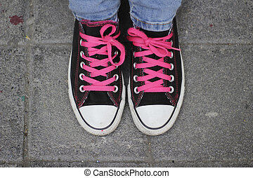 Classic tennis shoes and jeans - Photograph of a pair of...