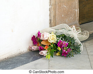 Mixed bouquet by doorway. Jilted bride maybe? - Beautiful...