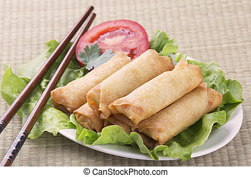 Traditional Chinese Spring Rolls on a bed of lettuce