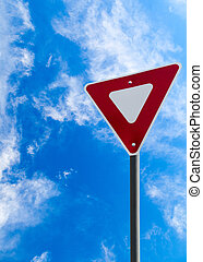 Traffic Yield Sign With Blue Sky Background and Copy Space -...