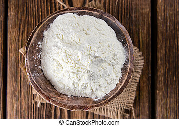 Portion of Milk Powder (selective focus) on an old wooden...