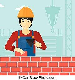 albañil, con, espátula, y, brick.,