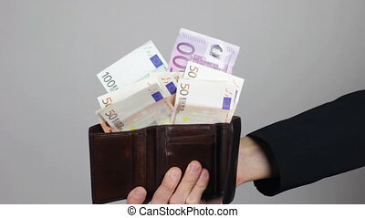 Showing a Wallet with Euro - Businessman hand showing a...