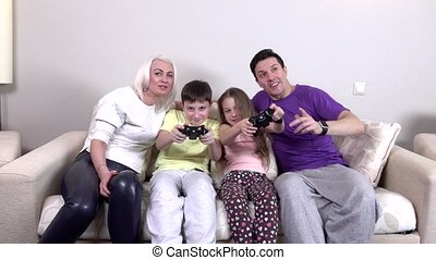 Happy family playing a video game, slowmotion - Happy...