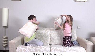 Pillow battle, slowmotion - Pillow battle, little girl and...