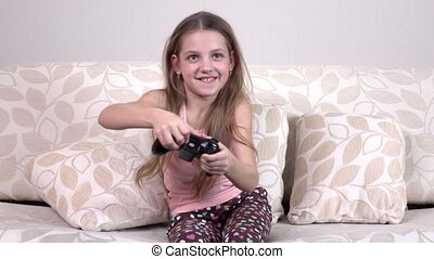 Happy girl playing video games, slowmotion - Happy girl...