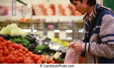 Man buys tomato vegetable in grocery shop 1920x1080 hd