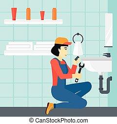Woman repairing sink. - An asian woman sitting in a bathroom...