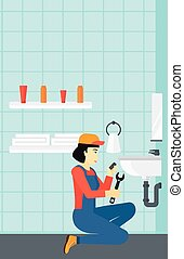 Woman repairing sink - An asian woman sitting in a bathroom...
