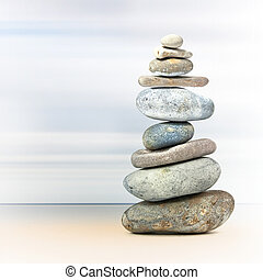 Balance tower of spa rocks - Tower of rocks to represent...