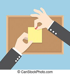 Businessman hands pin sticky notes on cork bulletin board