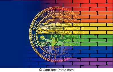 Rainbow Wall Nebraska - A well worn wall painted with a LGBT...