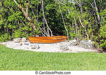 Old Boat in Sand by Lobster Trap by trees