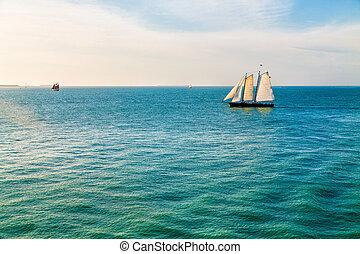 Schooner on Aqua Water - Schooner under sails sailing across...