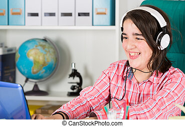 Teenage girl studying at home - Teenage studying by...