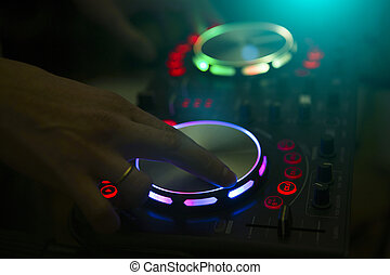 DJ console music party in nightclub