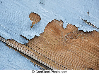 flakung blue paint - detail of blue flaking paint on wooden...