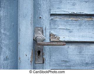 rundown blue door - detail of a old rundown blue wooden door...