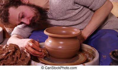 Creation of traditional clay pot - Experienced potter...