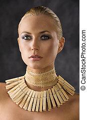 the peg necklace - portrait closeup of attractive blond...