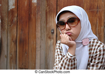 moslem girl - close up face of young and beautiful moslem...